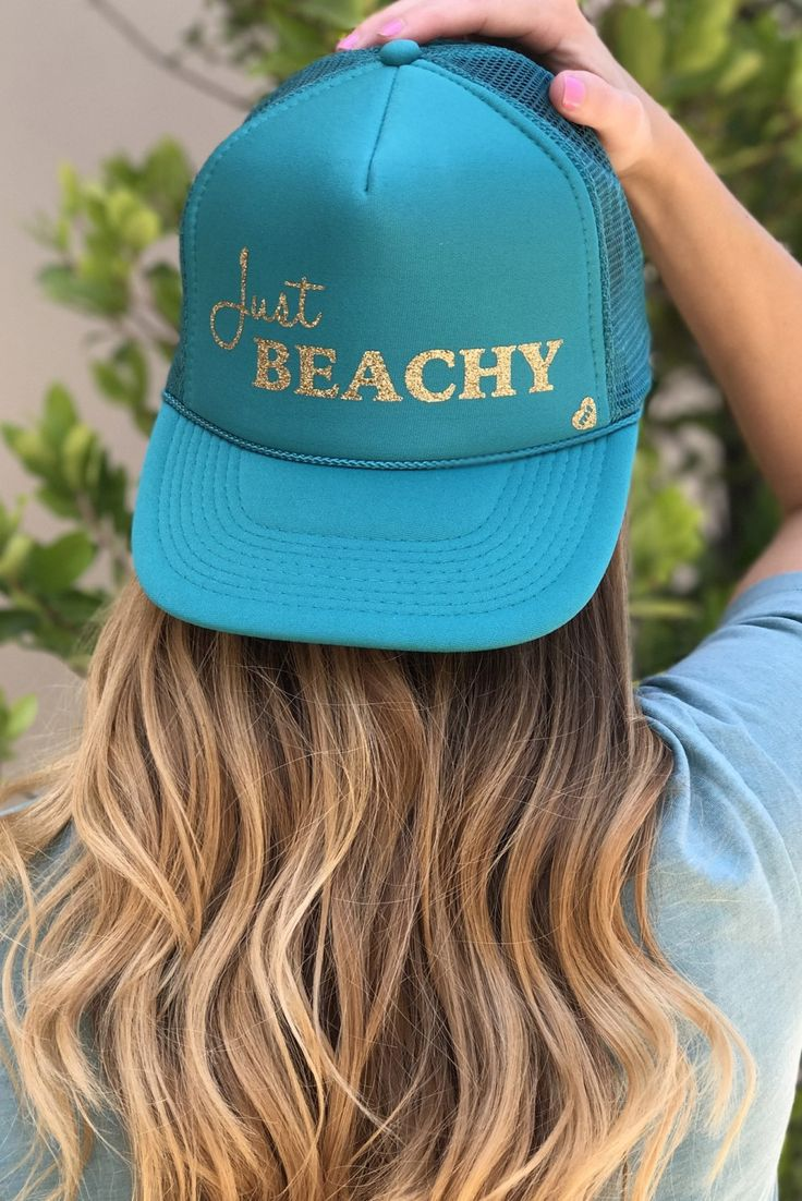 You'll have no complaints with your toes in the sand and the Mother Trucker Just Beachy Teal Blue Trucker Hat on your head! Shop this Mother Trucker hat and MORE at HERBOUTIQUE.COM!