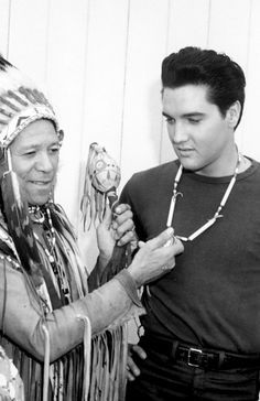 Elvis Presley is inducted into the Los Angeles Tribal Council by Chief Wha-Nee-Ota for his 'constructive portrayal of a man of Indian blood in Flaming Star ~ 1960