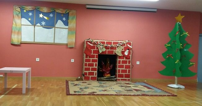 Christmas scene and handmade decor. The fireplace is made with cardboards.