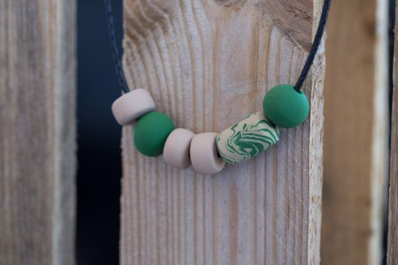 Polymer clay necklace. Tan and forest green by HandmadebyjoDesign