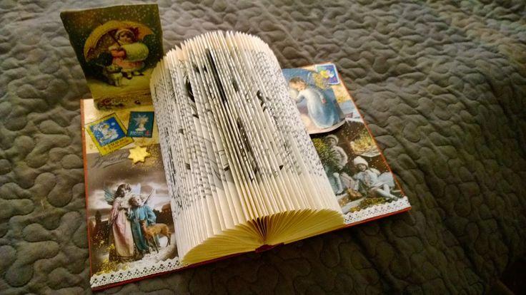 Foded book for Christmas cards. Kätevä joulukorttiteline vanhasta kirjasta ja jouluaiheisista kuvista.
