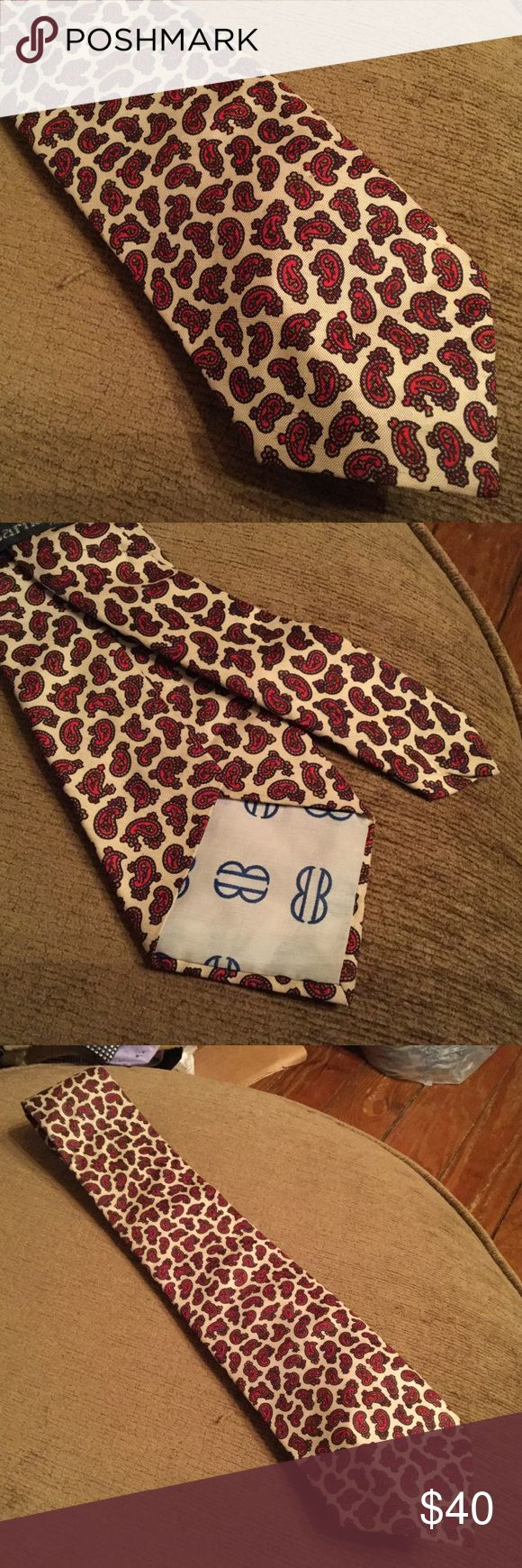 Vintage Bill Blass Men's Tie Red Paisley Barney's Excellent vintage Bills Blass men's tie for Barney's New York Silk Cream background with fancy red paisleys. No holes. No stains on the front. It looks like there is a discoloration on the narrow back side of the tie that wouldn't show when wearing. Bill Blass Accessories Ties