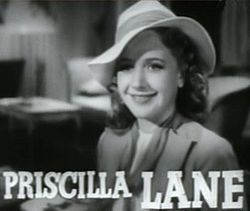 Priscilla Lane (June 12, 1915 – April 4, 1995) was an American actress. She is best remembered for her roles in the films The Roaring Twenties (1939), Saboteur (1942), a Hitchcock film in which she plays the heroine, and Arsenic and Old Lace (1944), where she plays Cary Grant's fiancée.