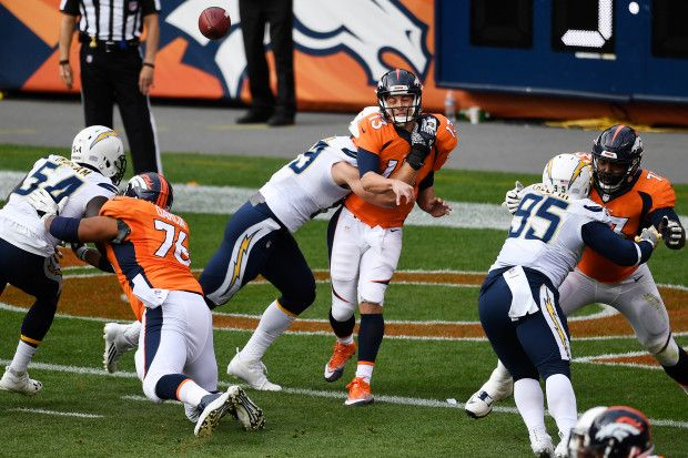 Chargers vs. Broncos:  October 30, 2016  -  27-19, Broncos  -       Joey Bosa (99) of the San Diego Chargers hits Trevor Siemian (13) of the Denver Broncos after he releases the ball during the first quarter on Sunday, October 30, 2016. The Denver Broncos hosted the San Diego Chargers.