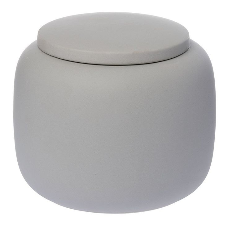 The raw collection continues with Zakkia's storage jar with lid. The storage uses are endless - bathroom, bedroom and kitchen storage.    Handmade by an amazing ceramic studio in northern Vietnam where they have been hand producing ceramics for over 900 years. The raw ceramic outer is complimented with a darker glaze inside to create a special tactile quality.