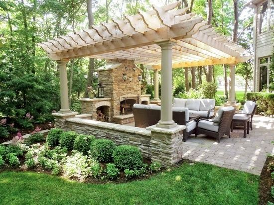 Outdoor living: pergola covered patio with firepla...