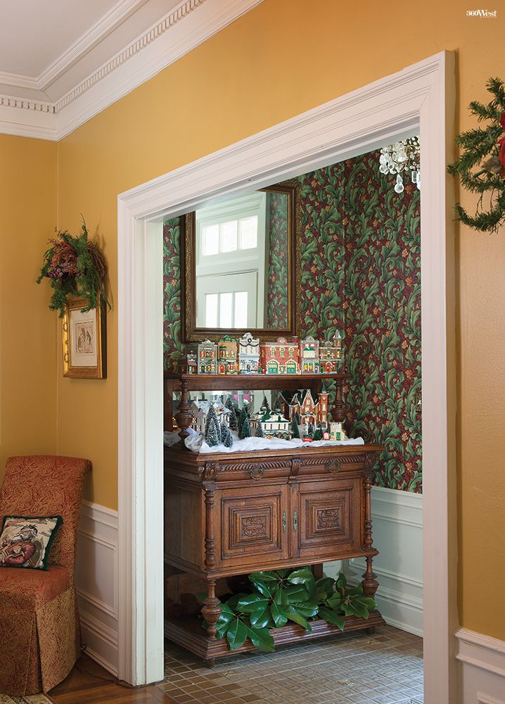 Susan Drakes Christmas Village Collection Fills An Antique Buffet In The Foyer 360 West Magazine December 2015