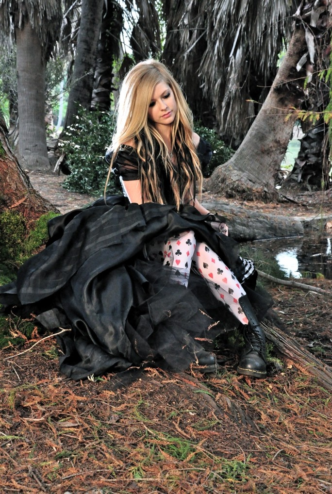 I love this shot of Avril Lavinge from her Alice single. I'd love to dress like this more often but there never seems to be the right occasion nowadays...