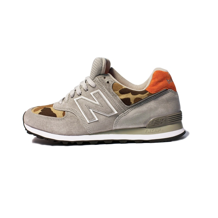 New Balance X Ball and Buck US574  $148.00  [...] we added a touch of Ball and Buck by integrating the signature Ball and Buck Camo in 10oz duck cloth that is both sophisticated and purposeful.  We finished off the shoe with a pop of color by using blaze orange for the heel tab and footbed to bring in the hunting inspiration that runs through all of our products.  The first release of 176 shoes will come with a vintage 50cal Ammo Can and hand stamped numbered brass plate.
