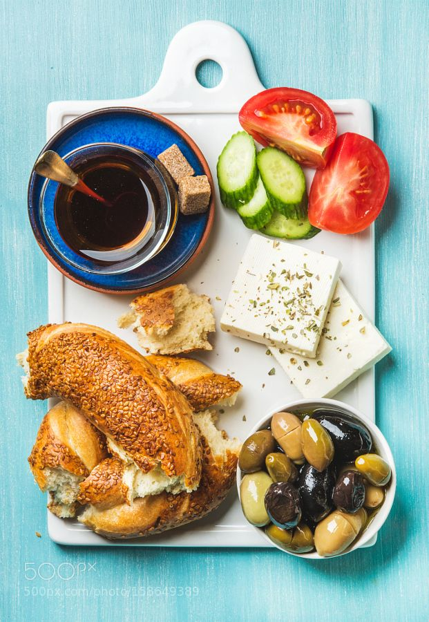 Pic: Turkish traditional breakfast with feta cheese, vegetables, olives, simit…