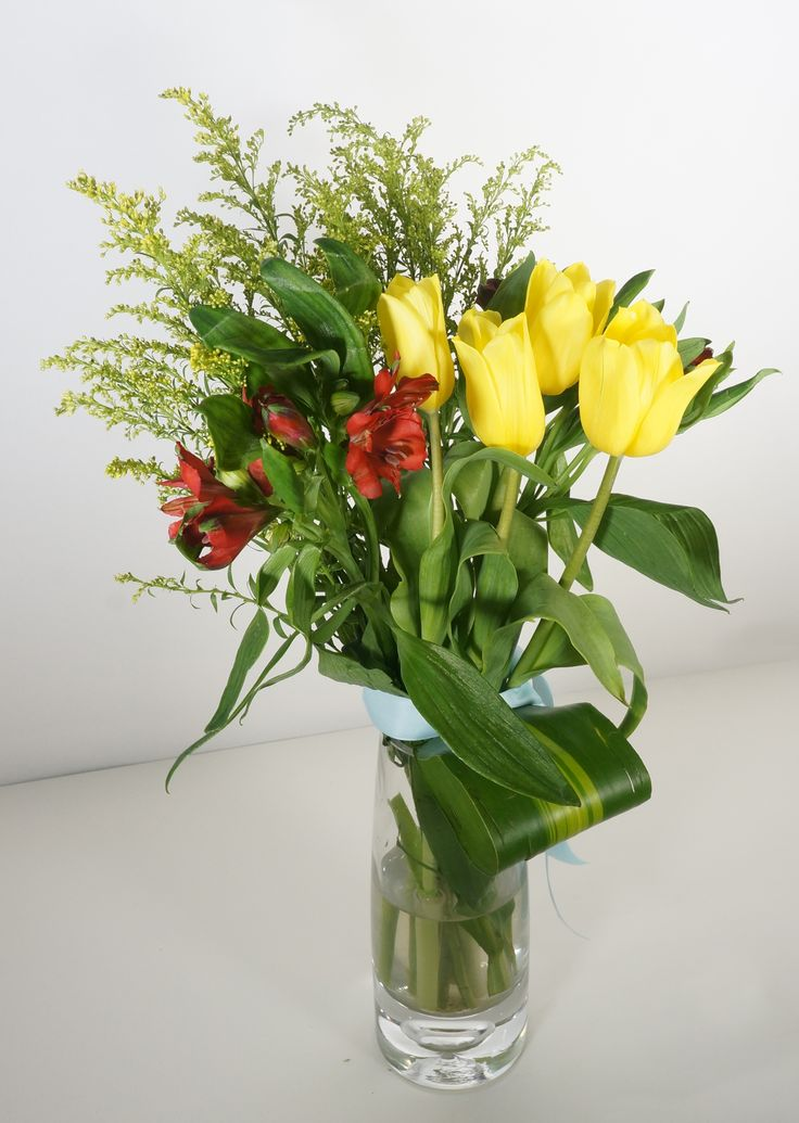 Mercury - A trendy stylish bouquet arrange by golden yellow tulips and luscious red blush lilies accented with fresh chartreuse greens, it is the perfect way to conscious someone you care. Mercury bouquet is suitable for every occasion. Vase Not Included. - See more at: http://www.timesflora.com/Mercury