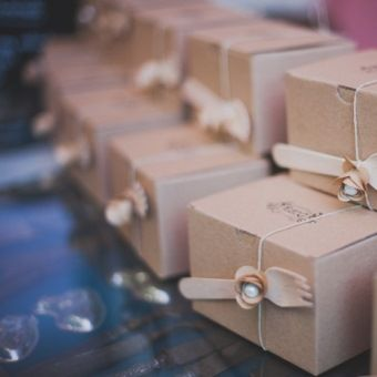 Cute paper box  with a wooden fork decorated with pearl and ribbon. Perfect gift for your wedding guests.