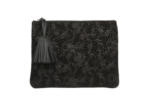 Editors Pouch Flower Party in black.  Executed in a monochromatic graphic floral, this pouch plays well with other prints.  Sling it crossbody, or tuck this versatile bag under your arm like a clutch.