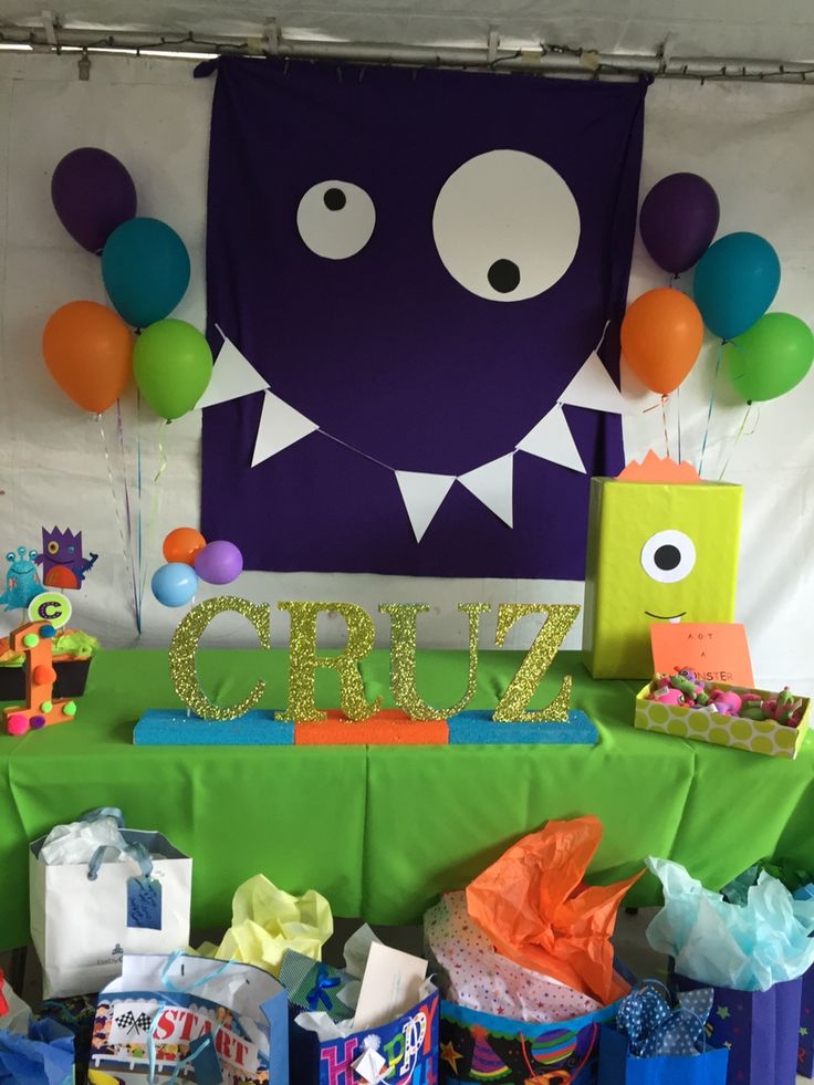 This is my Little Monsters 1st bday party. Lil monster theme. Purple material for monster face back drop.