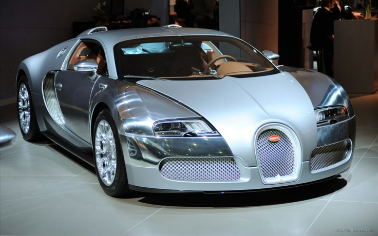 New Bugatti Veyron Wallpaper 1280x800  what an ugly looking pile of mobile scrap metal - yuk, horror cars of the centrury?