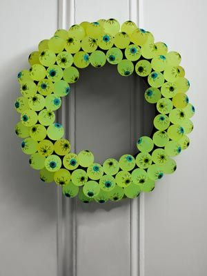 Eerie Eyeball Wreath  To create this eerie embellishment, you'll need about eight dozen glow-in-the-dark rubber eyeballs. Perhaps you can find some at the $ store??