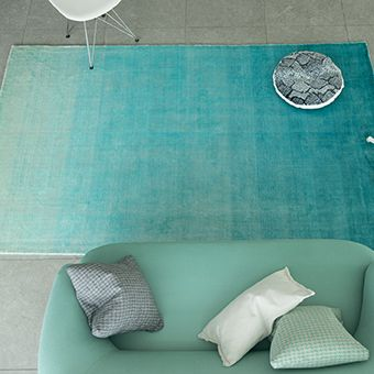 Stunning Eberson rug fading from bright turquoise to cool aqua
