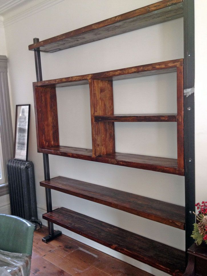 Custom shelving unit made from reclaimed wood and steel