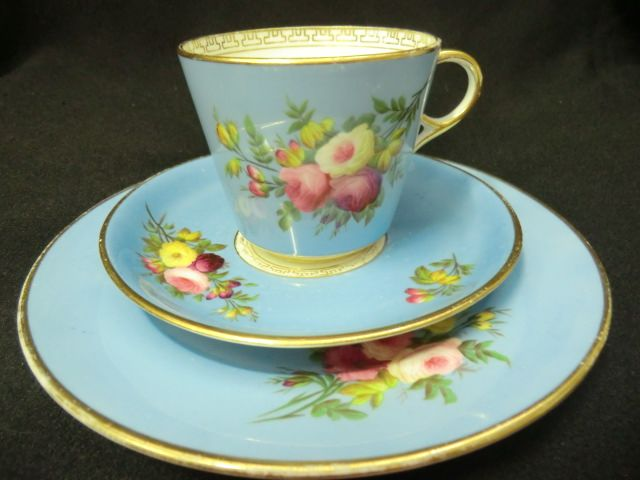 A beautiful CAREWORN Victorian tea trio One piece in the set impressed with Aynsley but this set is not marked Bucket shaped cup with supported ring