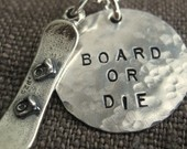 Snowboard Jewelry – Snowboarding Necklace – Hand Stamped 3/4″ Disc with Sterling Silver Snowboard Charm – Personalized.  I probably need this