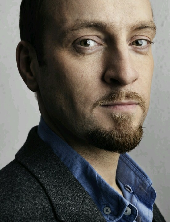 Derren Brown. Because he's talented on many levels. An amazing artist to boot. Would love to sit and have a drink with him.