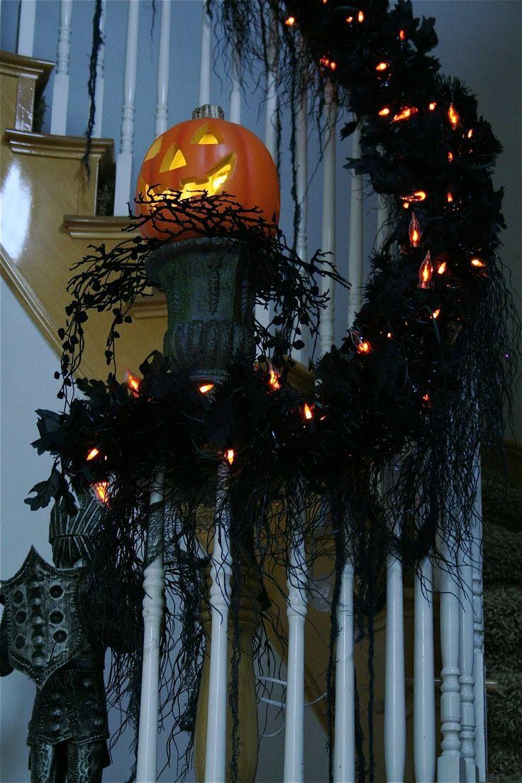 I really like the pumpkin set up on the black pedestal. .... halloween decor decorations