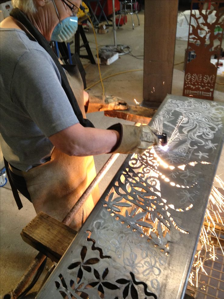 Plasma cutting a new Corten steel panel.