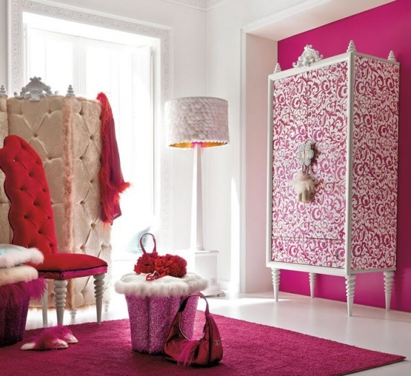 Love the stenciled dresser against the bright pink wall