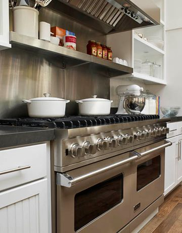 Ina's favorite combination — electric ovens for baking and gas burners for cooking — in two 30-inch Viking Professional Custom Series Dual-Fuel ranges finished in Stone Gray.