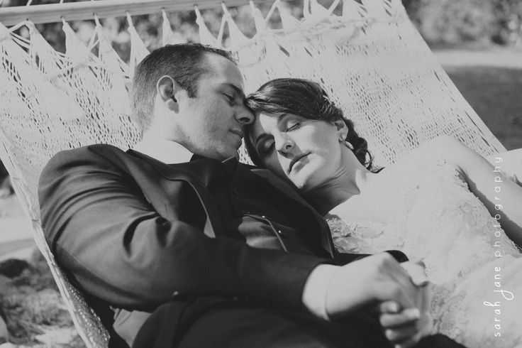 Bride and Groom laying in a hammock