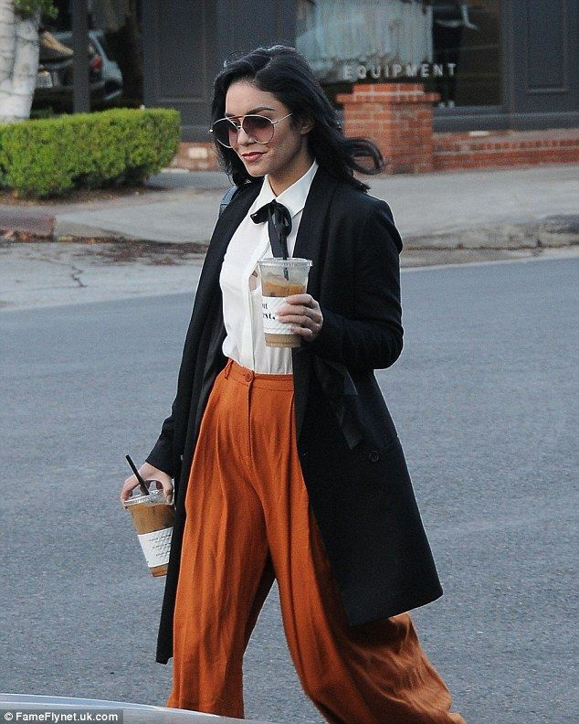 Dressed for fall: The Spring Breakers star wore a white shirt and smart black coat...
