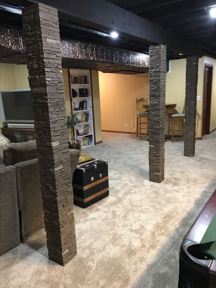 Basement Remodel To Cover Poles And Huge Ducts.