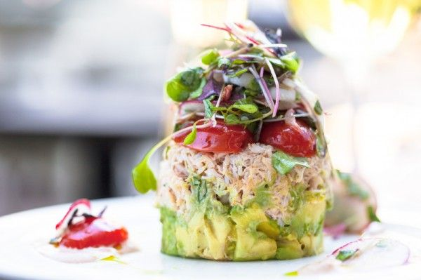 Crab Louie A typical Crab Louie salad consists of crab meat, hard boiled eggs, tomato, asparagus, cucumber and is served on a bed of Romaine lettuce with a Louie dressing based on mayonnaise, chili sauce and peppers on the side.