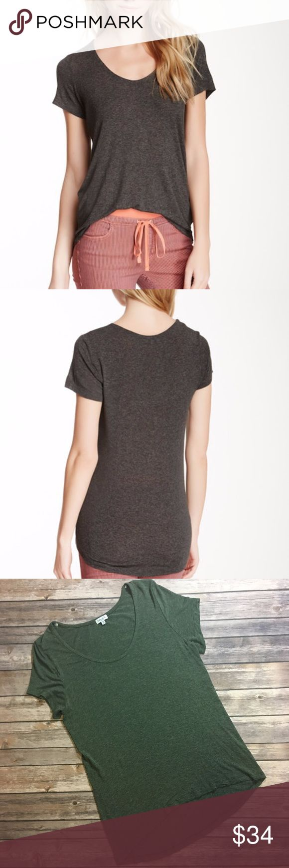 """Splendid Drapey Lux Short Sleeve T hi-lo scoopneck Currently sold out online! Scoop neck hi-lo tee from Splendid has a casual appeal with its slinky fabric style and subtly curved back hem. In a beautiful heathered green color. A stretchy and very very soft top! Stock photos show the same shirt, but a different color, in order to show fit. This shirt is exact one show in my photos-a grey-green heathered color  Perfect, like new condition. No flaws or wear.  Measurements: bust 18"""", length in…"""