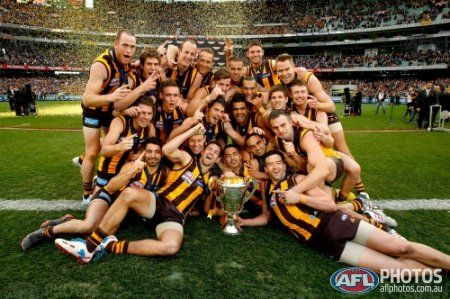 Hawthorn Hawks celebrate winning the 2013 Toyota Grand Final match between the Hawthorn Hawks and the Fremantle Dockers at the MCG, Melbourne on September 28, 2013. (Photo: Lachlan Cunningham/AFL Media)