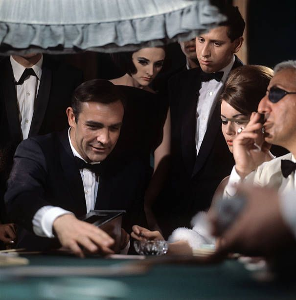In A Scene Of Thunderball The Actor Sean Connery In The Guise Of Mi6 Agent James Bond Has Just Won A Hand A Sean Connery Bond Girls Sean Connery James Bond