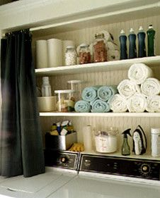 Storage with a curtain instead of doors - great way to being in the gray and green in my attached bathroom