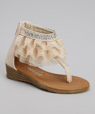 Featuring a diamond-adorned ankle strap with ruffled embellishments, this pair adds major charm and elegance to any gal's ensembles. A zipper in back provides easy access and a comfortable closed heel, while the open design brings in air for fresh feeling feet. Love this Beige Diamond Ruffle Wedge Sandal by Ameta Corporation on #zulily!