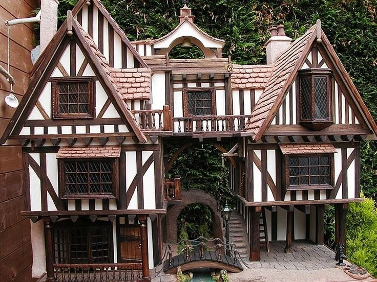"""Tudor Dollhouse Exteriors - With the end of the Wars of the Roses in 1485, the Tudors came to power and peace settled on the land. Castles were passé; the aristocracy """"downsized"""" to manor houses. Even though many were as large as the fortresses they replaced, the manor house was built to comfort the gentry, not repel invaders."""