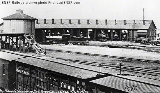 Early steam locomotives did not function well going in reverse. Instead, a turntable turned the locomotive around and then it was pulled into a stall for maintenance work. This 1890 photo shows a roundhouse of BNSF predecessor the Atlantic & Pacific Railroad (A&P) in Needles, Calif. Roundhouses featured a semicircle design to accommodate early steam locomotive's limited maneuvering capabilities. The owners of A&P incorporated the Saint-Louis and San Francisco Railway (Frisco) in 1876. In the…