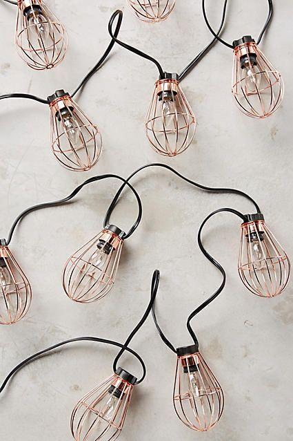 Caged Bulb String Lights, $58, Anthropologie -- rose gold!