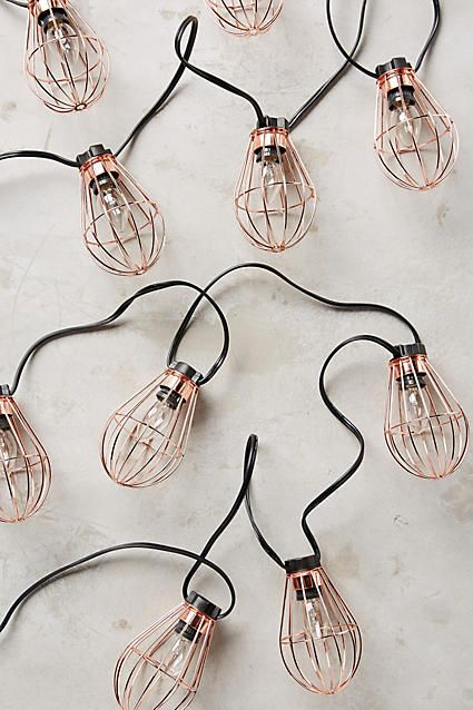 Caged Bulb String Lights, $58, Anthropologie -- rose gold!