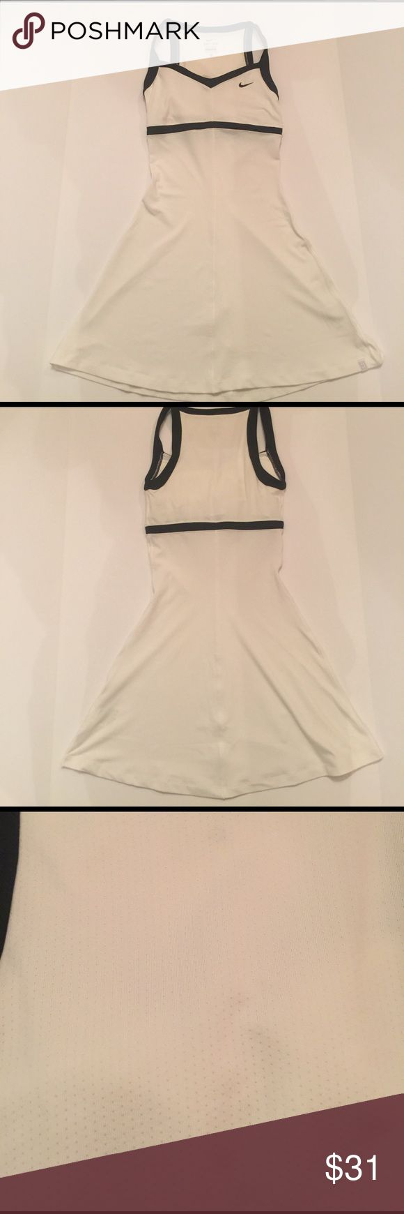 "Nike Dri Fit Tennis Dress 🎾 Never worn size xsmall made of 92% polyester and 8% spandex. Bust padding and mesh back. It measures approximately approximately 13"" flat underarm to underarm and measures approximately 31"" long from back of neckline to hem Nike Dresses"