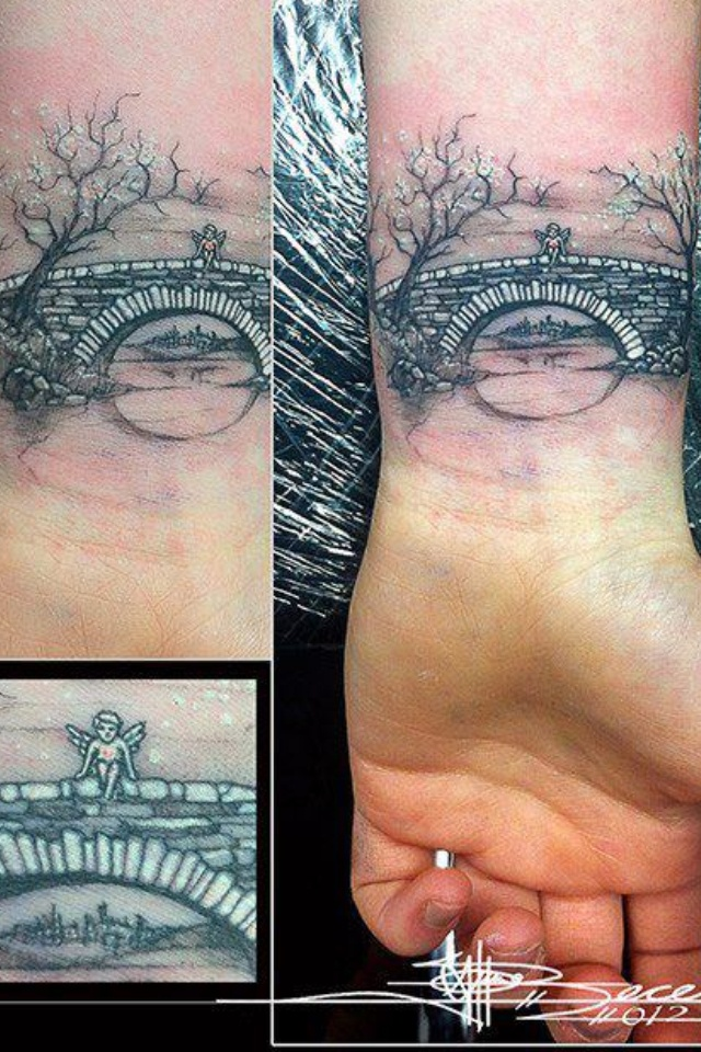 The detail in such a small space is amazing! Bridge and trees tattoo on the wrist with a tiny angel.