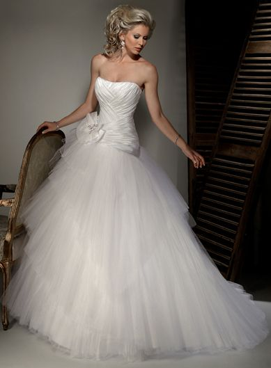 Wedding Dress Ideas Would look good with a pink bow!!