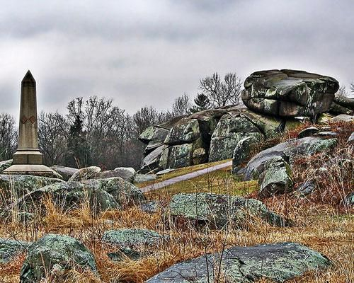 "Devil's Den, Gettysburg National Battlefield - The home of the bloodiest battle during the Civil War, reported to be haunted by a ghost known as ""The Hippie"" that has spoken to visitors to the park. Also reported are equipment malfunctions."