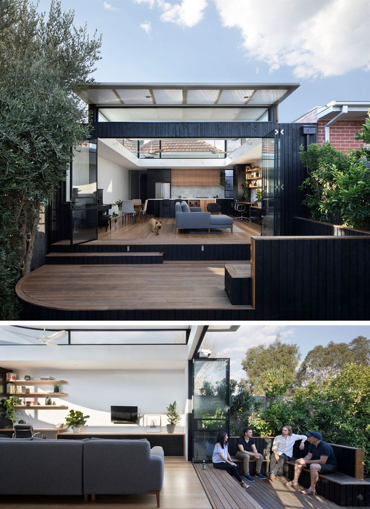 Ben Callery Architects have recently completed a contemporary extension to a brick house in Melbourne, Australia, that's home to a new open plan living space with a home office, dining area and kitchen, and opens out onto a wood deck with built-in seating.