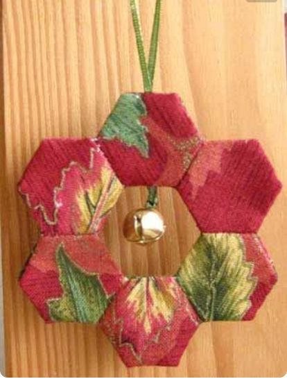"""Hexi Christmas Ornament is a great """"carry along project""""! Use the GO! English Paper Piecing Hexagon, sew hexagons together to make small wreaths, then sew front and back wreaths together on the machine. EASY! #accuquilt #christmasornaments #cuttimequiltmore"""