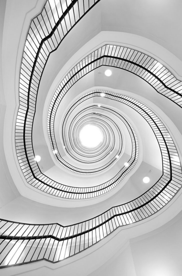 """Spiral staircase of """"Okraglak"""" modernism department store (now offices) in Poznan, Poland."""
