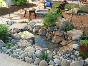 Yard Crashers in Sacramento, water feature and fire pit...